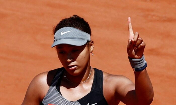 Japan's Naomi Osaka reacts during her first round match against Romania's Patricia Maria Tig in Roland Garros, Paris, France, on May 30, 2021. (Christian Hartmann/Reuters)