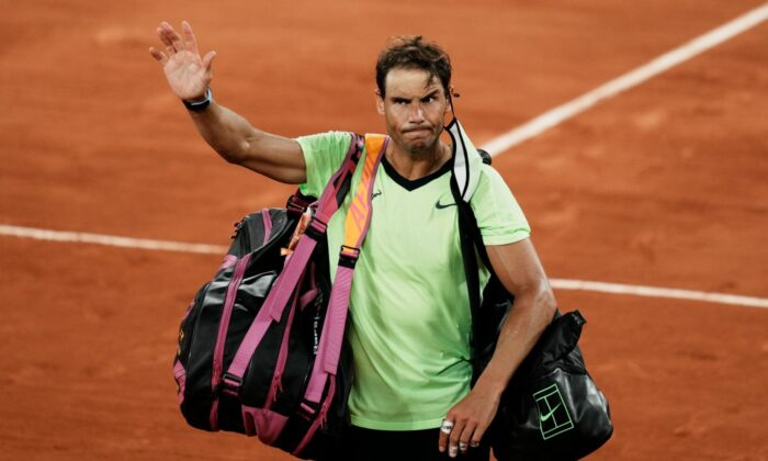 Spain's Rafael Nadal waves to the crowd after losing to Serbia's Novak Djokovic in their semifinal match of the French Open tennis tournament at the Roland Garros stadium in Paris on June 11, 2021. (Thibault Camus/AP Photo)