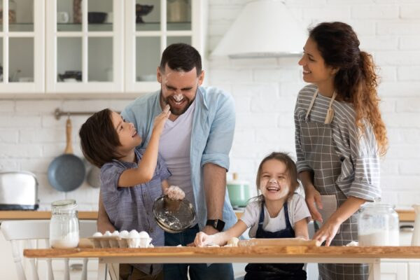 family having fun cooking and laughing together