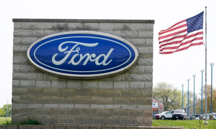 An American flag flies over a Ford auto dealership, in Waukee, Iowa, on April 27, 2021. (Charlie Neibergall/AP Photo)