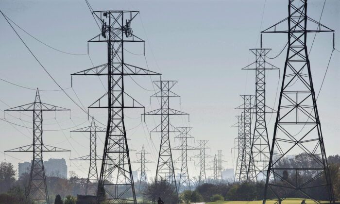 Hydro towers are seen over a golf course in Toronto in a file photo. (The Canadian Press/Darren Calabrese)