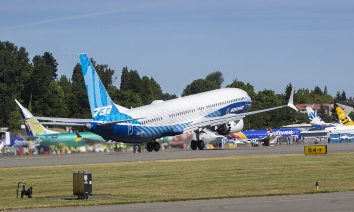 The final version of the 737 MAX, the MAX 10, passes other 737 MAX planes as it takes off from Renton Airport in Renton, Wash., on June 18, 2021. (Ellen M. Banner/The Seattle Times via AP, Pool)