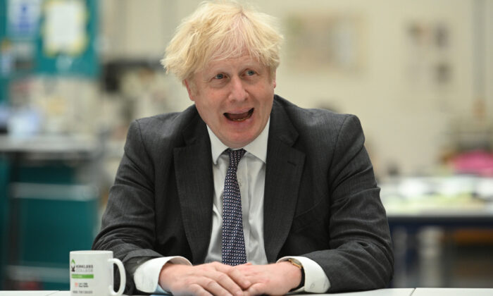 Prime Minister Boris Johnson talks with lecturers and students in the Arts and Design department during a visit to Kirklees College Springfield Sixth Form Centre in Dewsbury, West Yorkshire, England, on June 18, 2021. (Oli Scraff/PA)