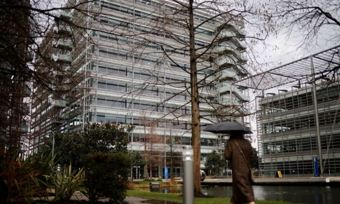A pedestrian walks past an office block that houses the offices of China's CGTN Europe (China Global Television Network), in Chiswick Park, west London, on Feb. 4, 2021. The UK's broadcast regulator on Aug. 26 revoked the license of Chinese news network CGTN after finding its state-backed ownership structure flouted British law, and warned of punishment ahead after it aired an alleged forced confession. (Tolga Akmen/AFP via Getty Images)