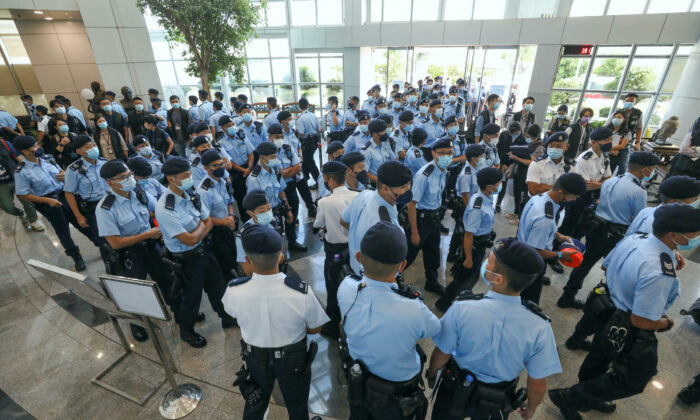 Police officers conduct a raid at the Apple Daily office in Hong Kong on June 17, 2021. (Apple Daily via Getty Images)