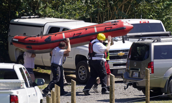 Rescue personnel stage along the Dan River in Eden, N.C., on June 18, 2021. (Gerry Broome/(AP Photo)
