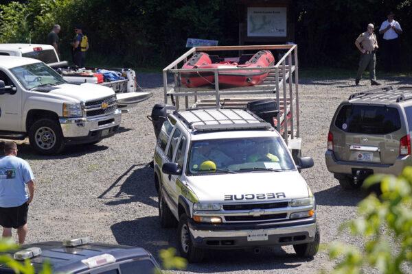 Rescue personnel stage along the Dan River