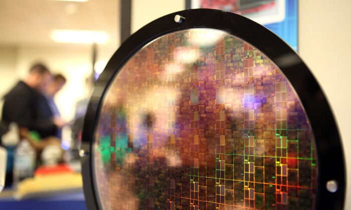 A silicon wafer is displayed during a technology event in San Jose, Calif, on March 23, 2011. (Justin Sullivan/Getty Images)