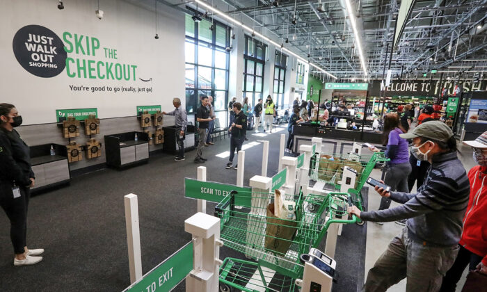 Customers using cashierless technology to checkout with an app or credit card at the first Amazon Fresh in Bellevue, Wash., on opening day, on June 17, 2021. (Ken Lambert/Seattle Times/TNS)