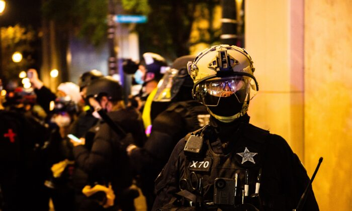 "Portland Police deploy in Portland, Oregon on Nov. 4, 2020, during a demonstration called by the ""Black Lives Matter"" movement, a day after the US Presidential Election. (Kathryn Elsesser/AFP via Getty Images)"
