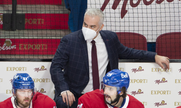 Montreal Canadiens coach Dominique Ducharme keeps an eye on the action, as do Paul Byron (41) and Phillip Danault (24) during the the team's NHL hockey game against the Ottawa Senators in Montreal, Canada, on March 2, 2021. (Ryan Remiorz/The Canadian Press via AP)