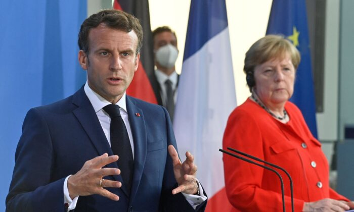 French President Emmanuel Macron gestures during a joint press conference with German Chancellor Angela Merkel ahead of talks at the Chancellery in Berlin on June 18, 2021. (John Macdougall/AFP via Getty Images)