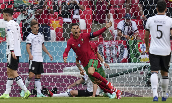 Portugal's Cristiano Ronaldo celebrates after scoring the opening goal during the Euro 2020 soccer championship group F match between Portugal and Germany in Munich, Germany, on June 19, 2021. (Matthias Schrader/Pool/AP Photo)