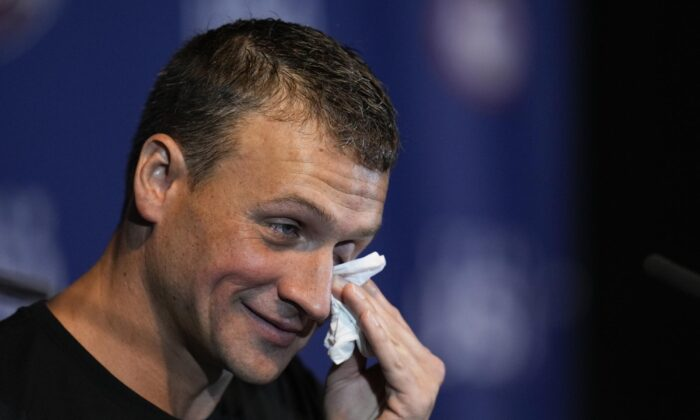 Ryan Lochte crys during an interview after the men's 200 individual medley during wave 2 of the U.S. Olympic Swim Trials in Omaha, Neb., on June 18, 2021. (Jeff Roberson/AP Photo)