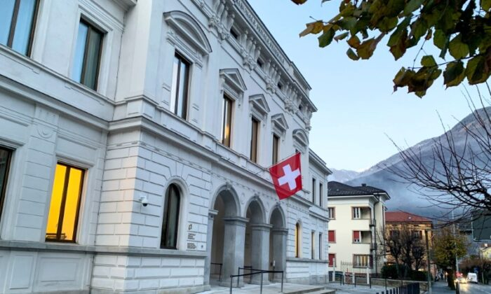 Switzerland's national flag is displayed on the Swiss Federal Criminal Court (Bundesstrafgericht) building in Bellinzona, Switzerland, on Dec. 3, 2020. (Emma Farge/Reuters)