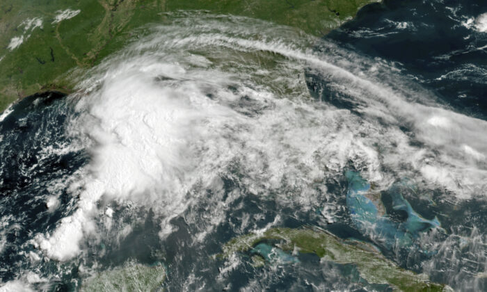 A tropical weather system in the Gulf of Mexico in this GOES-16 GeoColor satellite image taken at 11 a.m. ET on June 18, 2021. (NOAA via AP)