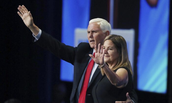 Former Vice President Mike Pence and Second Lady Karen Pence wave after he spoke during the Road to Majority convention at Gaylord Palms Resort & Convention Center in Kissimmee, Fla., on June 18, 2021. (Stephen M. Dowell/Orlando Sentinel via AP)