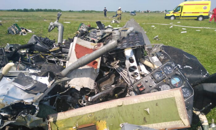 A view shows the wreckage of an L-410 plane that crashed near the Tanay aerodrome, which provides parachuting services, in Kemerovo Region, Russia, on June 19, 2021. (Investigative Committee of Russia/Handout via Reuters)