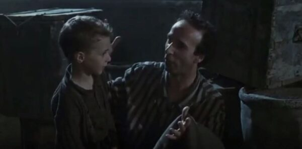 young boy in cell with father