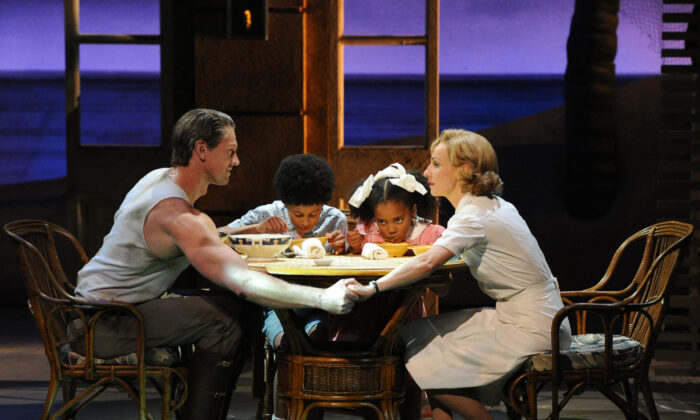 """(L –R) New Zealand's Teddy Tahu Rhodes as Emile De Becque, with Jamal Sydney Bednarz as Jerome, Ayanda Dladla as Ngana, and Australia's Lisa McCune as Nellie Forbush for the Lincoln Center Theater production of """"South Pacific"""" at the Sydney Opera House in 2012. (TORSTEN BLACKWOOD/AFP/Getty Images)"""