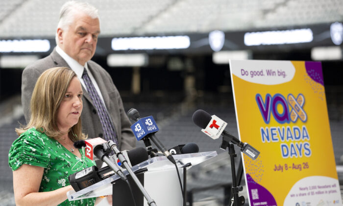 """Heidi Parker, executive director of Immunize Nevada, helps to announce a COVID-19 vaccine incentive program, """"Vax Nevada Days,"""" in the Twitch Lounge at Allegiant Stadium in Las Vegas on June 17, 2021. (Ellen Schmidt/Las Vegas Review-Journal via AP)"""
