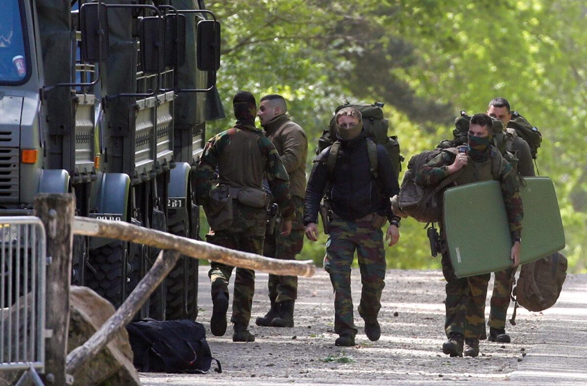 Belgian-army-members-carry-bags