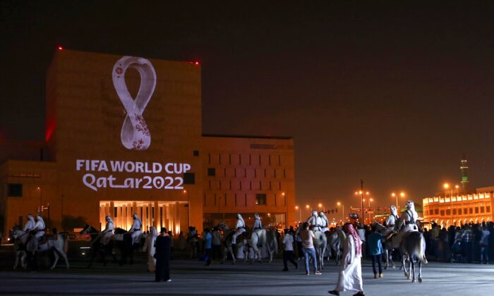 Qataris gather at the capital Doha's traditional Souq Waqif market as the official logo of the FIFA World Cup Qatar 2022 is projected on the front of a building, on Sept. 3, 2019. (AFP via Getty Images)