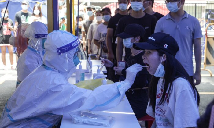 A woman takes a COVID-19 test in Guangzhou, in China's southern Guangdong Province, on May 30, 2021. (STR/AFP via Getty Images)