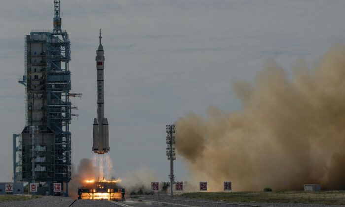 The manned Shenzhou-12 spacecraft from China's Manned Space Agency onboard the Long March-2F rocket launches with three Chinese astronauts onboard at the Jiuquan Satellite Launch Center in China's Gansu Province, on June 17, 2021. (Kevin Frayer/Getty Images)