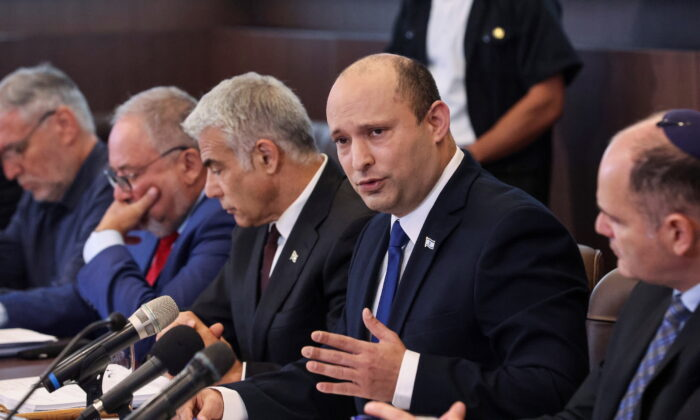 Israeli Prime Minister Naftali Bennett speaks as he chairs the first weekly cabinet meeting of his new government in Jerusalem, on June 20, 2021. (Emmanuel Dunand/Pool via Reuters)
