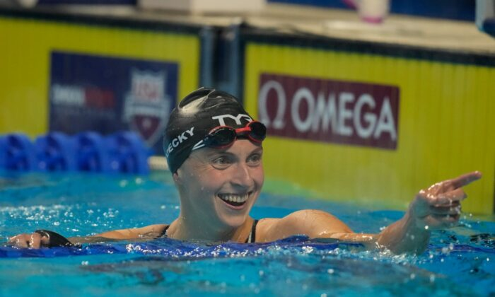 Katie Ledecky reacts after the women's 800 freestyle during wave 2 of the U.S. Olympic Swim Trials in Omaha, Neb., on June 19, 2021. (Charlie Neibergall/AP Photo)