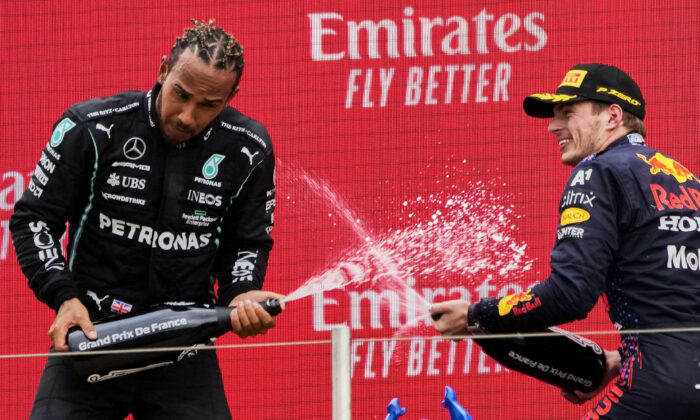 Red Bull driver Max Verstappen of the Netherlands (R) celebrates from the podium after winning, with second place Mercedes driver Lewis Hamilton of Britain (L) from the podium during the French Formula One Grand Prix at the Paul Ricard racetrack in Le Castellet, southern France, on June 20, 2021. (Francois Mori/AP Photo)