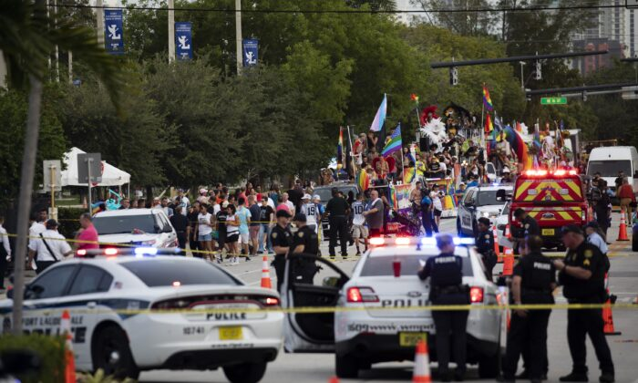 Police and firefighters respond after a truck drove into a crowd of people injuring them during The Stonewall Pride Parade and Street Festival in Wilton Manors, Fla., on June 19, 2021. (Chris Day/South Florida Sun-Sentinel via AP)
