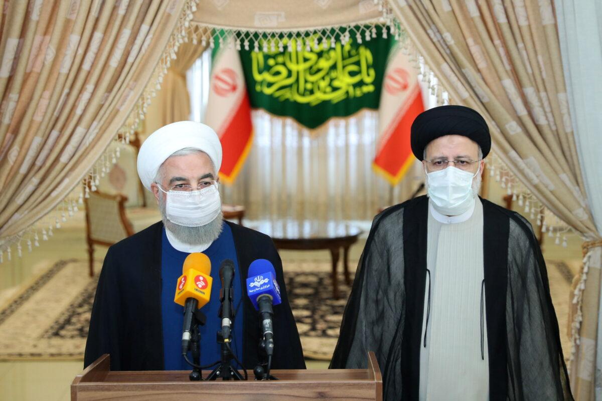 Hassan Rouhani and Ebrahim Raisi