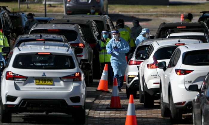 Health staff register residents at a COVID-19 drive through testing site on Bondi Beach in Sydney after the reports of the four fresh positive cases on June 17, 2021. (SAEED KHAN/AFP via Getty Images)