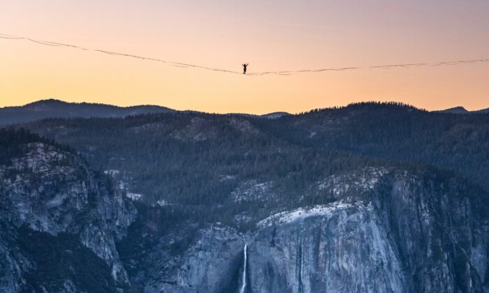 Highliner Daniel Monterrubio walks the 2,800-foot-long line off Taft Point above Yosemite Valley in Yosemite, Calif., on  June 12, 2021. (Scott Oller/Scott Oller Films via AP)