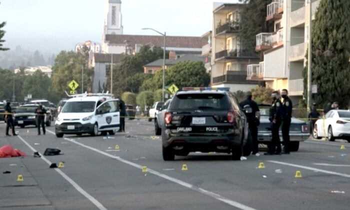 Police officers at the scene of a shooting in Oakland, Calif., on June 19, 2021. (AIO Filmz/Screenshot via NTD)