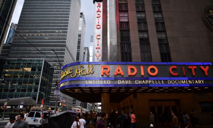 Radio City Music Hall's marquee advertises Dave Chappelle's untitled documentary during the closing night celebration for the 20th Tribeca Festival in New York City, on June 19, 2021. (Charles Sykes/Invision/AP)