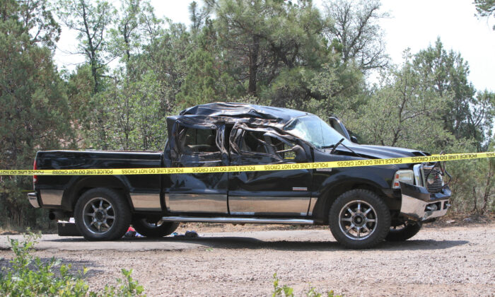 A crashed pick up truck which ran over a group of cyclists in Show Low, Ariz., on June 19, 2021. (Jim Headley/The White Mountain  Independent via AP)