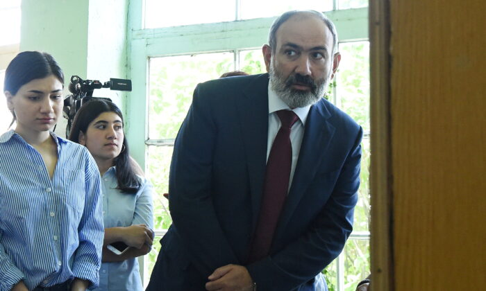 Armenia's acting Prime Minister and leader of Civil Contract party Nikol Pashinyan visits a polling station to cast his vote during the snap parliamentary election in Yerevan, Armenia, on June 20, 2021. (Lusi Sargsyan/Photolure via Reuters)