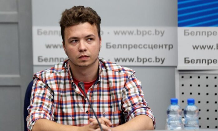 Belarusian dissident journalist Raman Pratasevich attends a news conference at the National Press Center of Ministry of Foreign Affairs in Minsk, Belarus on June 14, 2021. The dissident Belarusian journalist who was arrested when his airliner was diverted to Minsk was brought to a Foreign Ministry news conference on Monday, prompting a foreign journalist to walk out in protest. The opposition said the Monday appearance by Raman Pratasevich showed he is a hostage. (Ramil Nasibulin/BelTA pool photo via AP)