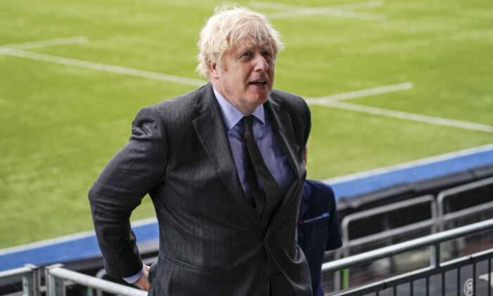 Prime Minister Boris Johnson during a visit to a CCP virus vaccination centre at the StoneX Stadium, home of rugby union club Saracens, in north London on June 21, 2021. (Alberto Pezzali/PA Wire)