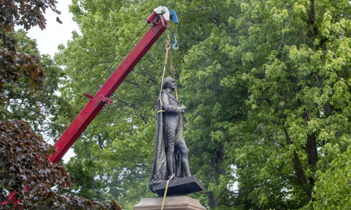 The statue of Sir John A. Macdonald is removed from a park in his hometown of Kingston, Ont., on June 18, 2021. (The Canadian Press/Lars Hagberg)