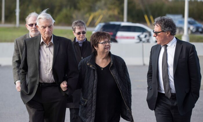 (L–R) Doug and Donna French, parents of murder victim Kristen French, with their lawyer Tim Danson after Paul Bernardo's parole hearing at Millhaven Institution in Bath, Ont., on Oct. 17, 2018. Bernardo was again denied parole on June 22, 2021. (The Canadian Press/Lars Hagberg)