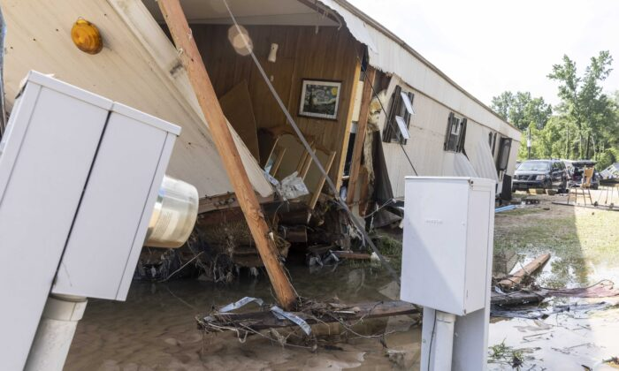 A home at lot 226 was destroyed by heavy flooding at 2823 Hunter Creek Road in Northport, Ala., on June 20, 2021. (Vasha Hunt/AP Photo)