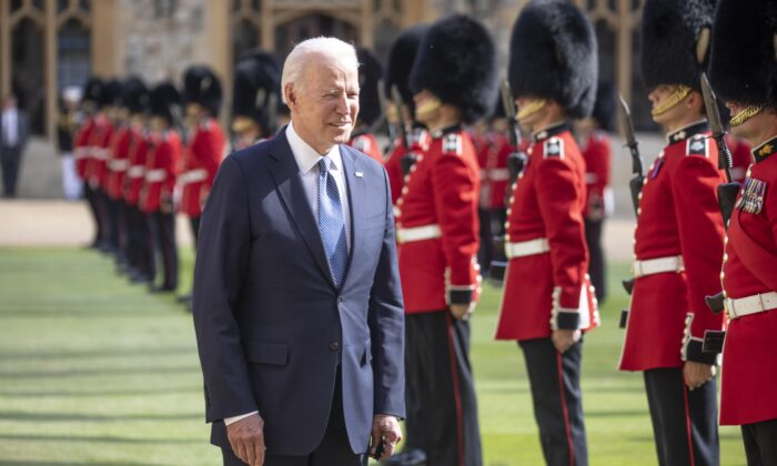 President Joe Biden inspects the ranks of a Guard of Honour formed of The Queen's Company First Battalion Grenadier Guards during a visit to Windsor castle to meet Queen Elizabeth II, in Windsor, England, on June 11, 2021. (Richard Pohle/WPA Pool/Getty Images)