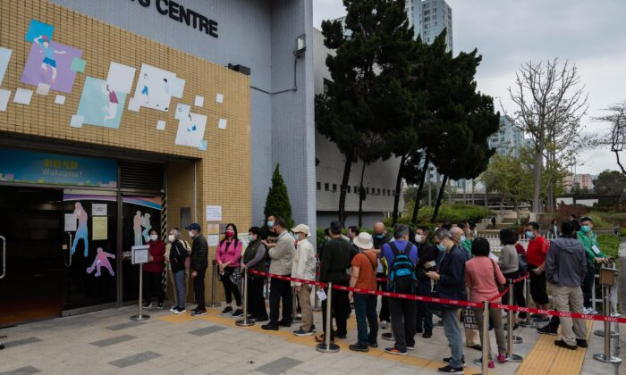 People line up at a community vaccination center administering the Sinovac Biotech Ltd. Covid-19 vaccine in Hong Kong, on Feb. 26, 2021. (Billy H.C. Kwok/Getty Images)