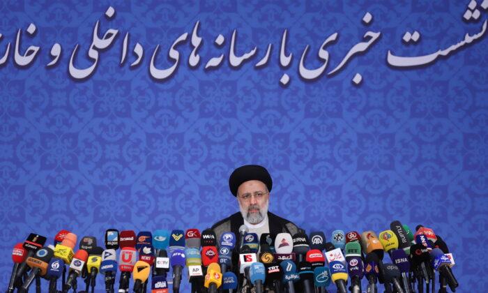 Iran's President-elect Ebrahim Raisi attends a news conference in Tehran, Iran, on June 21, 2021. (Majid Asgaripour/WANA via Reuters)