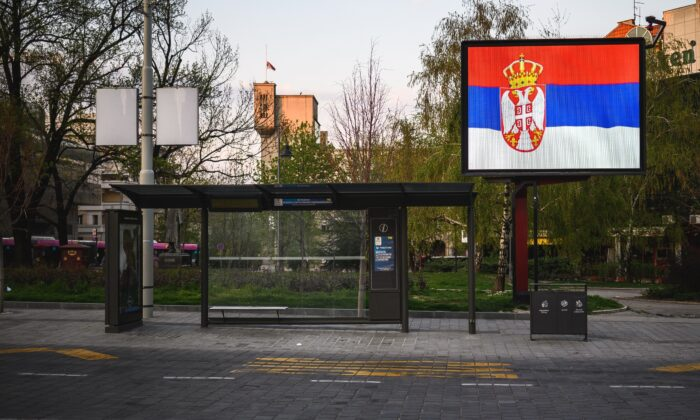 The Serbian national flag displayed on a billboard in a file photo. (Andrej Isakovic/AFP via Getty Images)