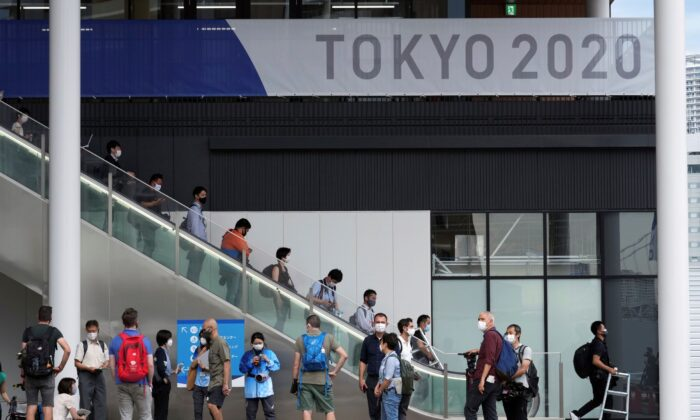 Journalists gather at Multifunctional Complex at the Tokyo 2020 Olympic and Paralympic Village during a media tour in Tokyo, on June 20, 2021. (Eugene Hoshiko/AP Photo)